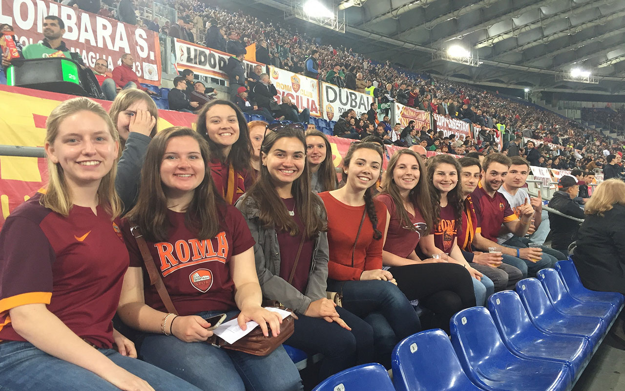 Assumption students enjoy a Roma football game.