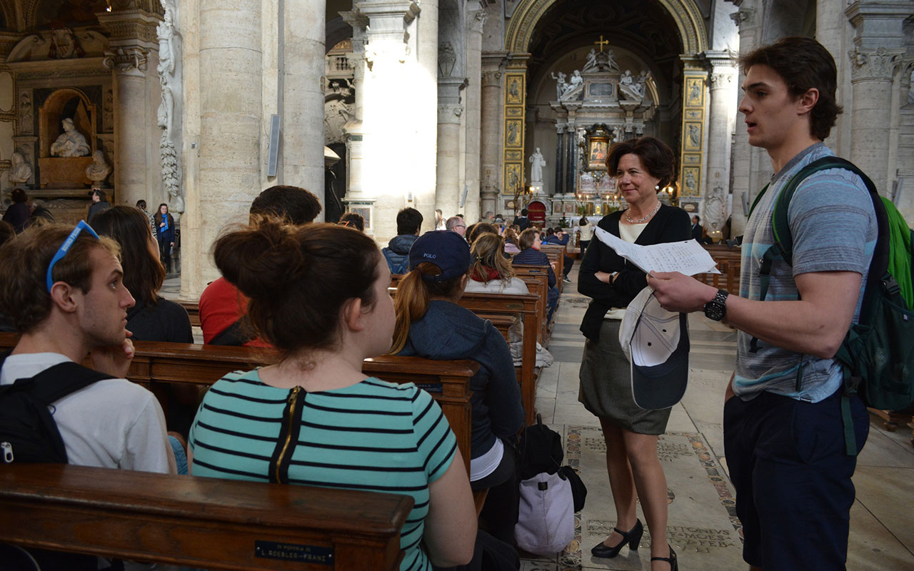 Assumption students studying at the College's Rome Campus in an art history class in the 541-year-old  Basilica of Santa Maria del Popolo.