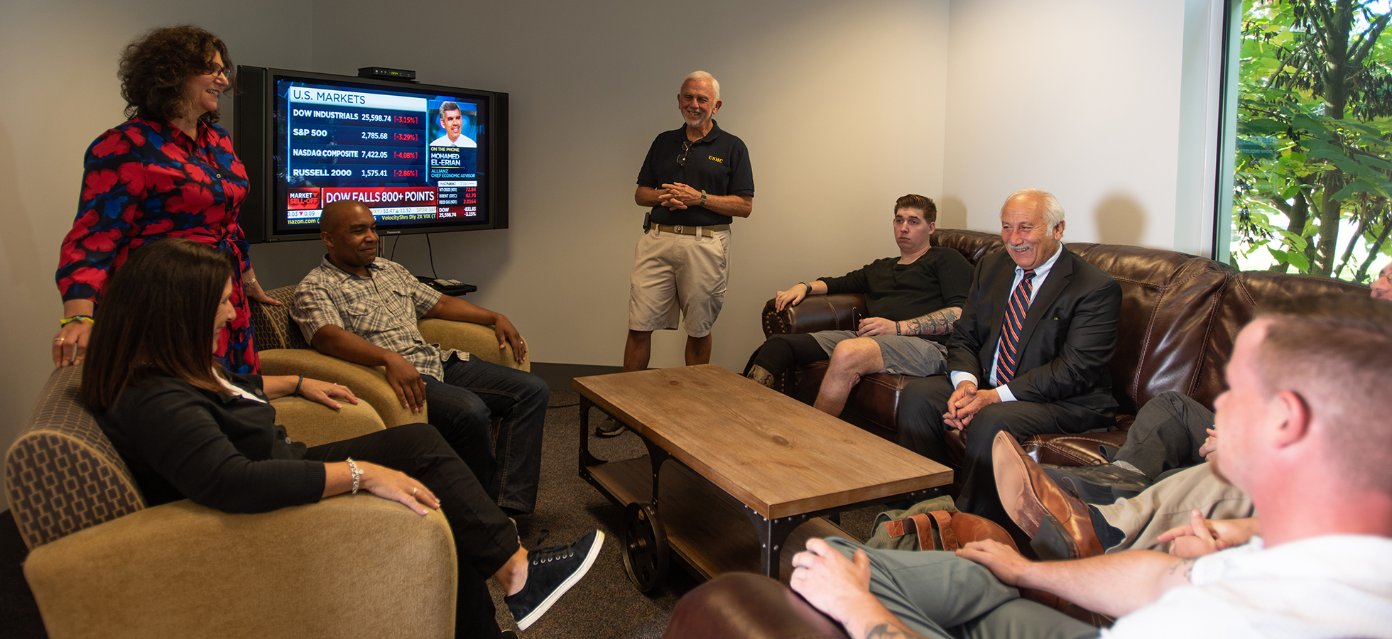 Assumption College faculty, administrators and students in the new Veterans' Lounge.
