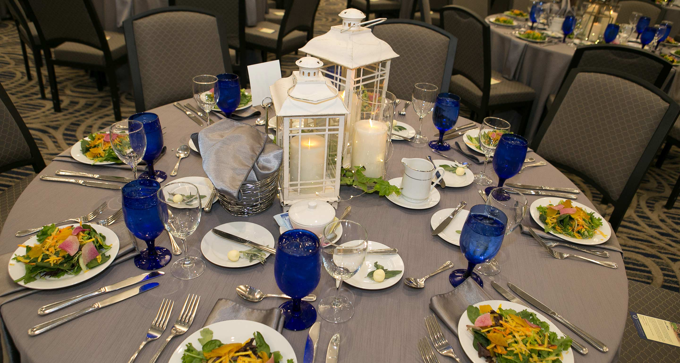 A table set for dinner in the 350-seat ballroom of the Tsotsis Family Academic Center on the campus of Assumption College.