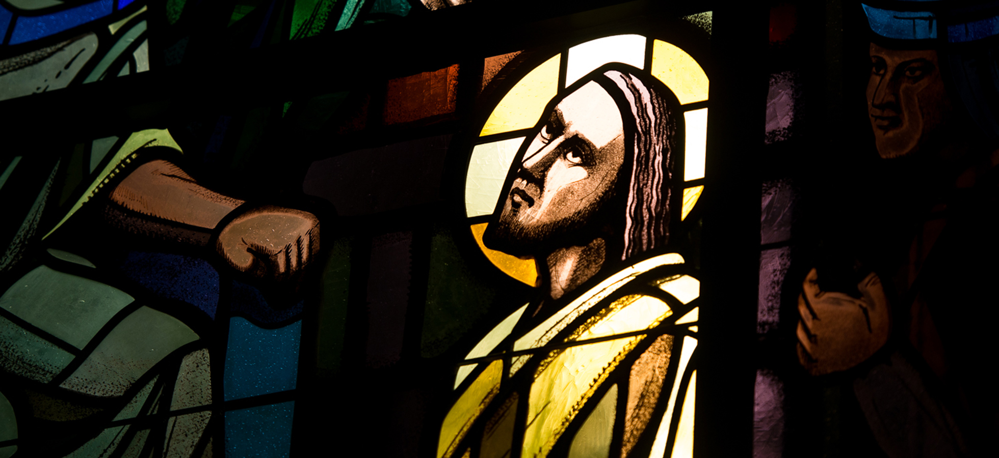 Stained glass window depicting Christ in the Chapel of the Holy Spirit at Assumption in Worcester.