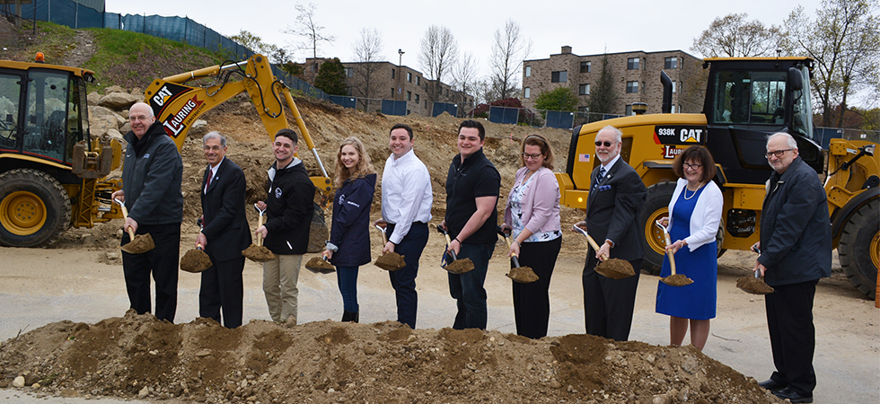 Assumption Faculty, Staff, and Students turning the dirt at the Health Sciences groundbreaking event.