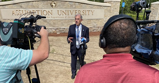 Assumption University President Francesco Cesareo being interviewed by media.